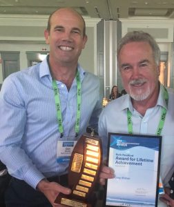 Greg Britton (on right) with Lifetime achievement award with colleague Dan Messiter